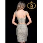 white golden coloured dress. sleeveless crop top with short skirt